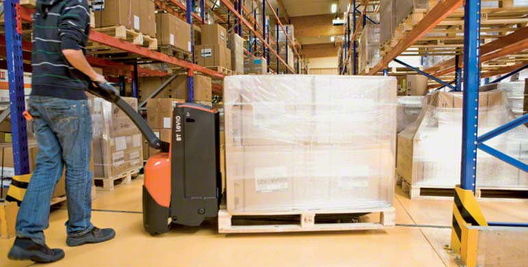 The motors in the electric pallet truck are used to both move and raise the pallet off the floor.