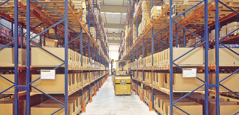 Operator working on a lower level of pallet racking