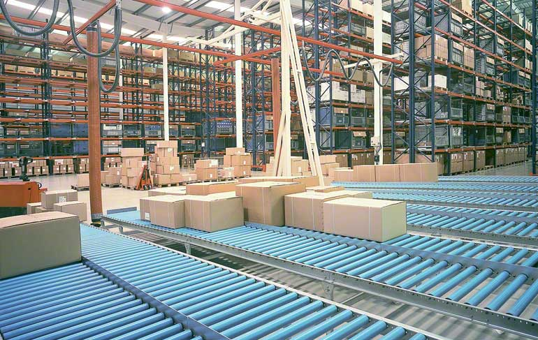 The image shows an order picking area in a warehouse for faucets and bathroom accessories.