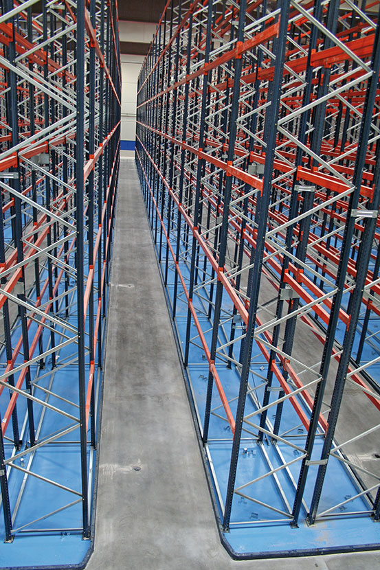 Checking warehouse floor are level is hard work