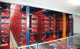 This automated miniload warehouse is comprised of fourteen linear racks served by seven stacker cranes