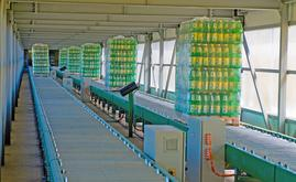 The warehouse is connected with the production area via a 100 m long overpass fitted with roller conveyors