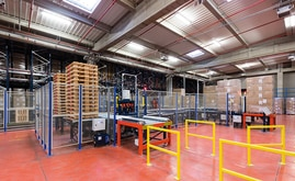 Front of the warehouse the inputs and outputs of palletised goods are produced automatically via a conveyor circuit