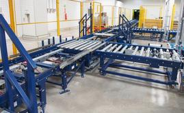 Incoming palletised goods from production are carried by means of the main conveyor circuit