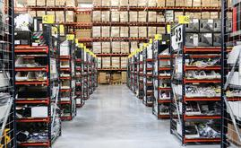 This warehouse composed of pallet racking, picking shelves for boxes and a conveyor circuit that includes a sorting zone