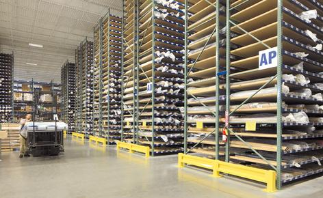 A special pallet racking solution sorts out the storage and handling of fabric rolls
