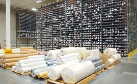 This warehouse solution enabling the storage of a great amount of fabric rolls and to locate them quickly