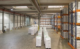 The warehouse has two distinct areas composed of drive-in and conventional pallet racking systems