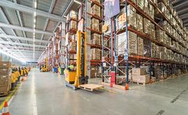 The forklift trilateral trucks placing the pallets on the Conventional Pallet Racking